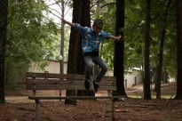 Nigual Jumping Off Park Bench
